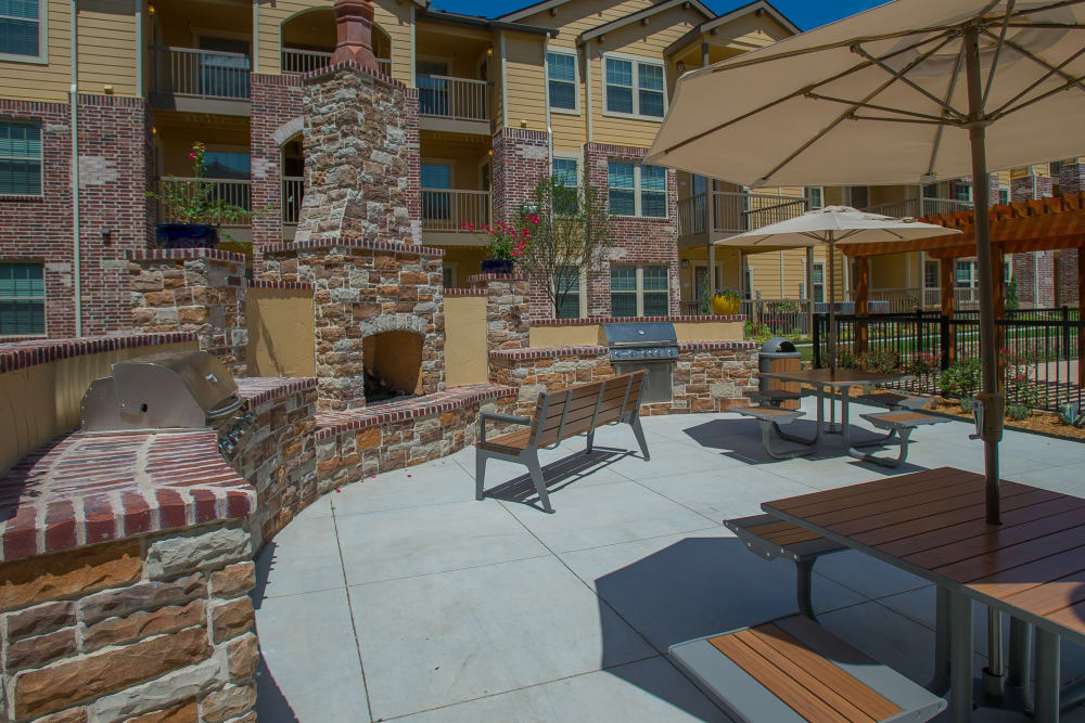 Outdoor patio with grills at Tuscany Ranch in Waco, Texas