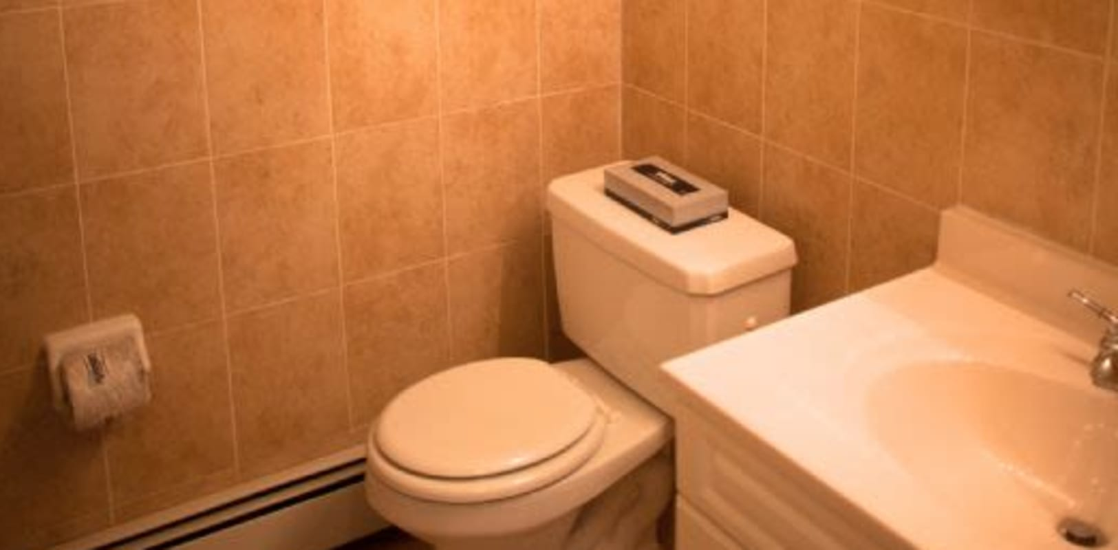 Tile style walls in bathroom at Wynbrook West Apartments in East Windsor, New Jersey