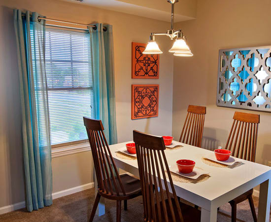 Bright dining area at Rochester Village Apartments at Park Place in Cranberry Township, Pennsylvania