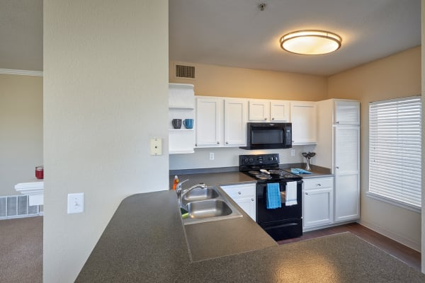White Kitchen Cabinetry at Skyecrest Apartments in Lakewood, CO