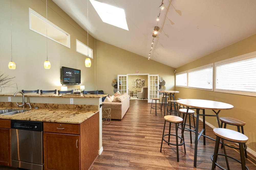 Community kitchen space in clubhouse at Hampden Heights Apartments in Denver, Colorado