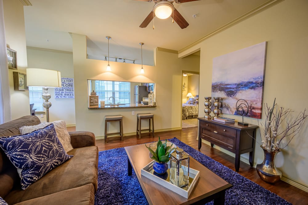 Living room with lovely wood floors at Pecan Springs Apartments in San Antonio, Texas