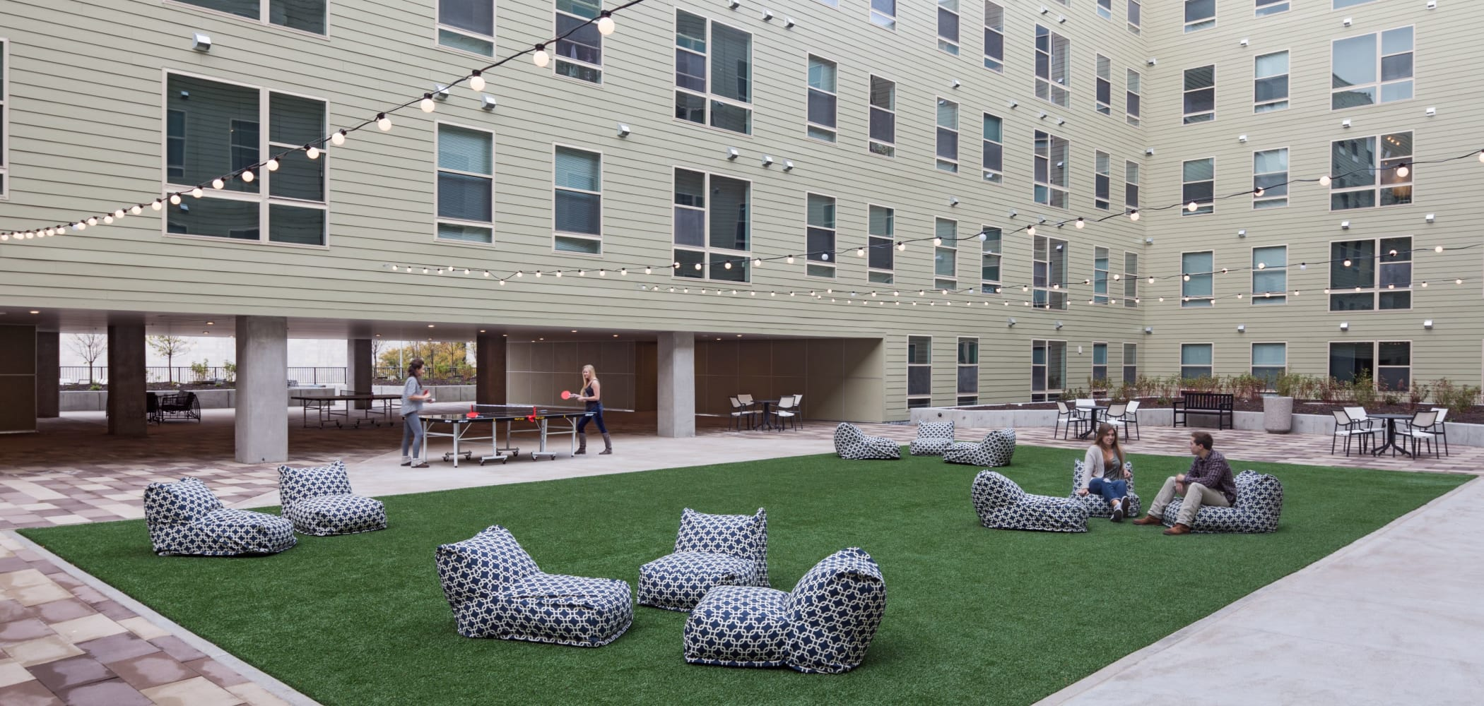 Community courtyard with games at LATITUDE in Lincoln, Nebraska