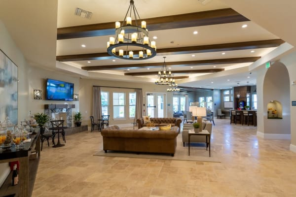 Reception area with wooden ceiling beams and chandeliers at a property by WRH Realty Services, Inc