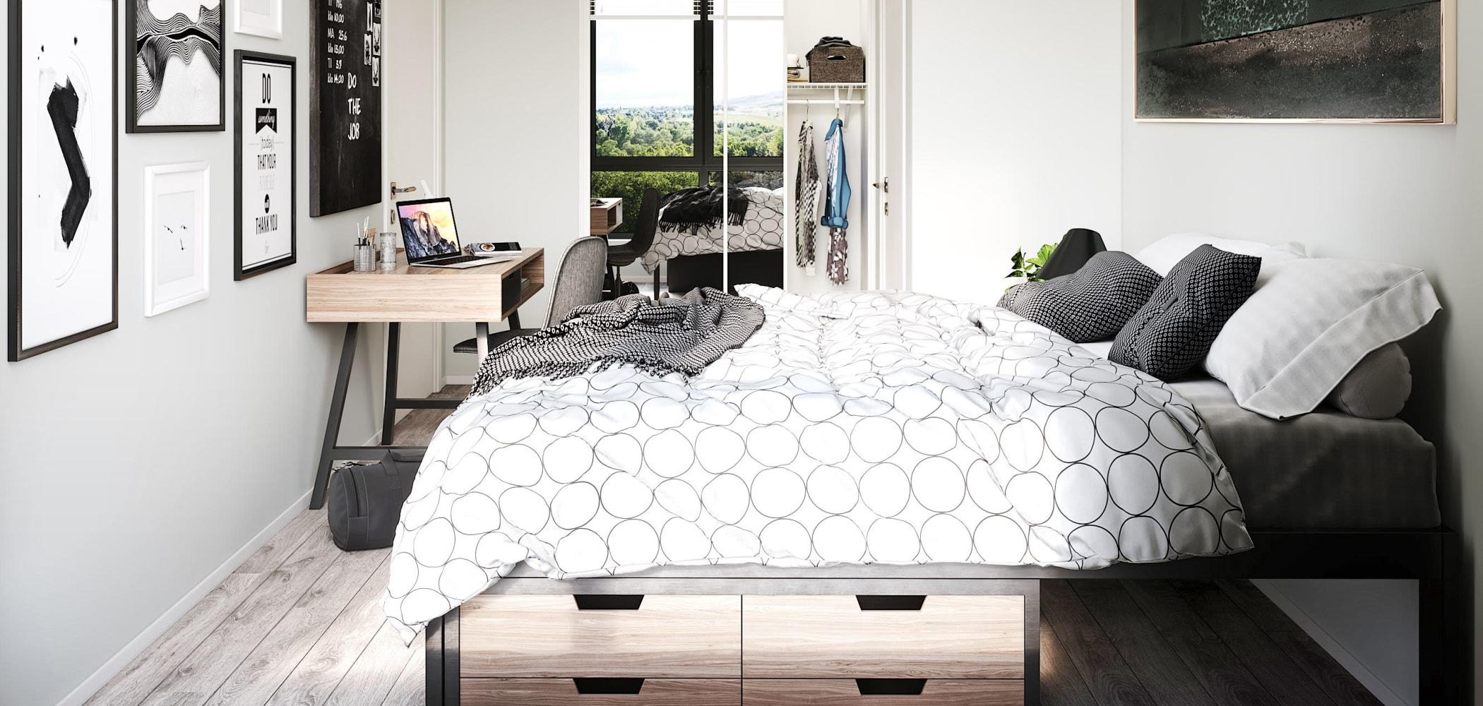 Bright bedroom with a study area at UNCOMMON Reno in Reno, Nevada