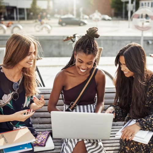 Resident chatting on campus near IDENTITY Miami in Miami, Florida