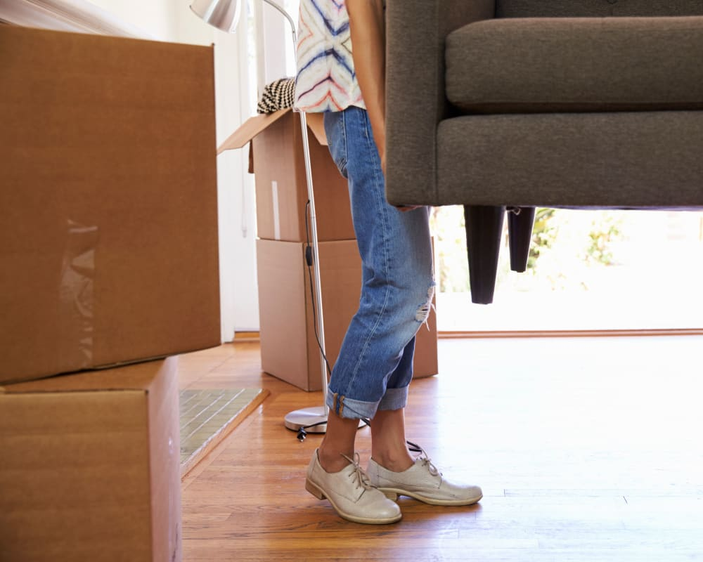 A woman moving furniture to store at A-1 U-Store-It in Vancouver, Washington