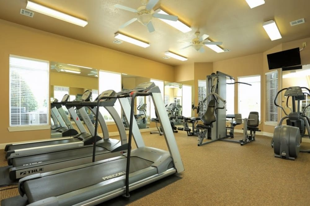 Fully equipped fitness center at Harbin Pointe Apartments in Bentonville, Arkansas