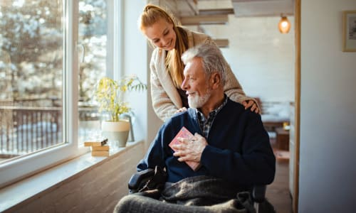 Resident and caring caregiver at RockBrook Memory Care in Lewisville, Texas