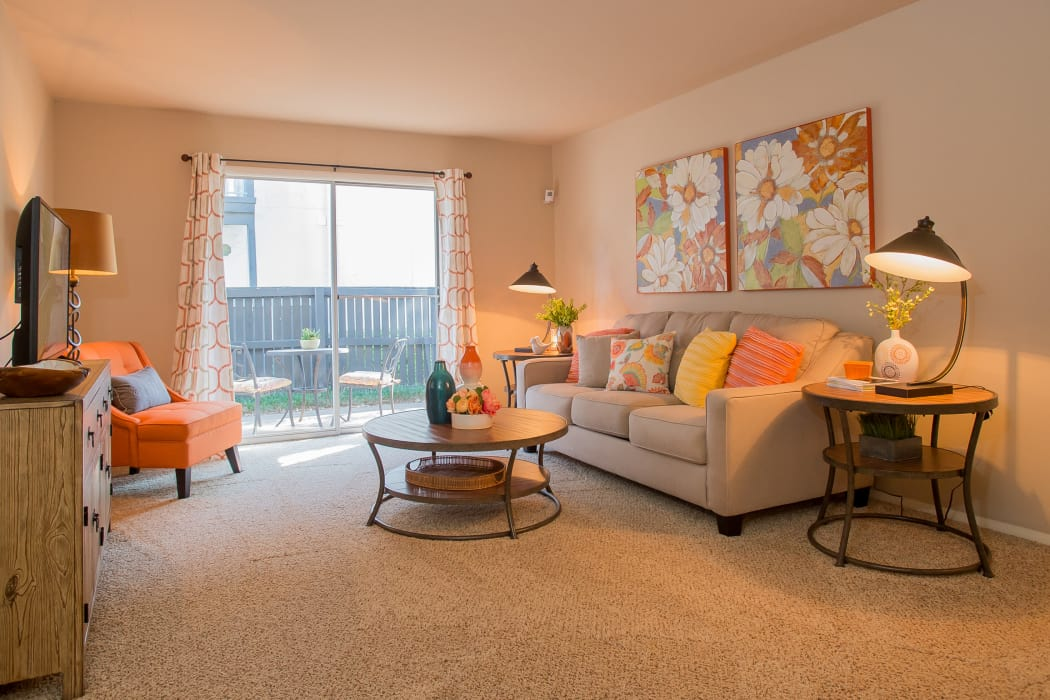 Bright living room at Barcelona Apartments in Tulsa, Oklahoma