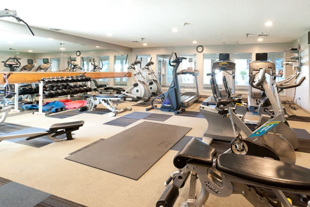 A spacious community gym at Pointe West Apartment Homes in West Des Moines, Iowa