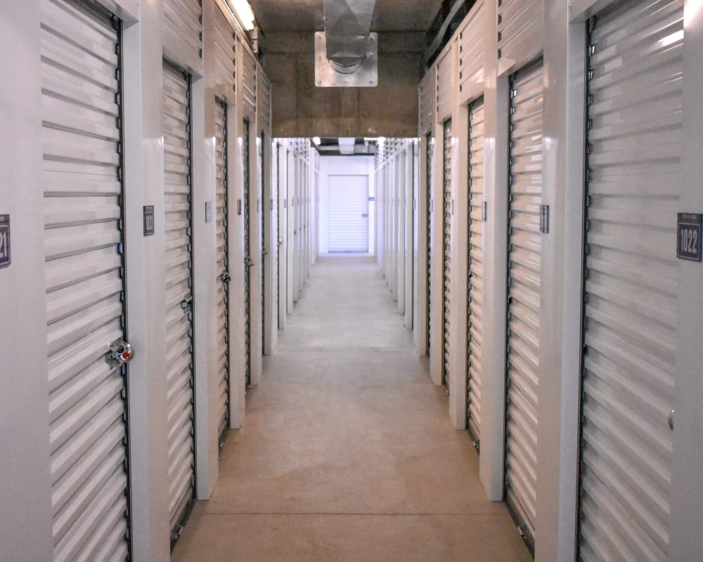 White doors on interior climate-controlled storage units at STOR-N-LOCK Self Storage in Henderson, Colorado
