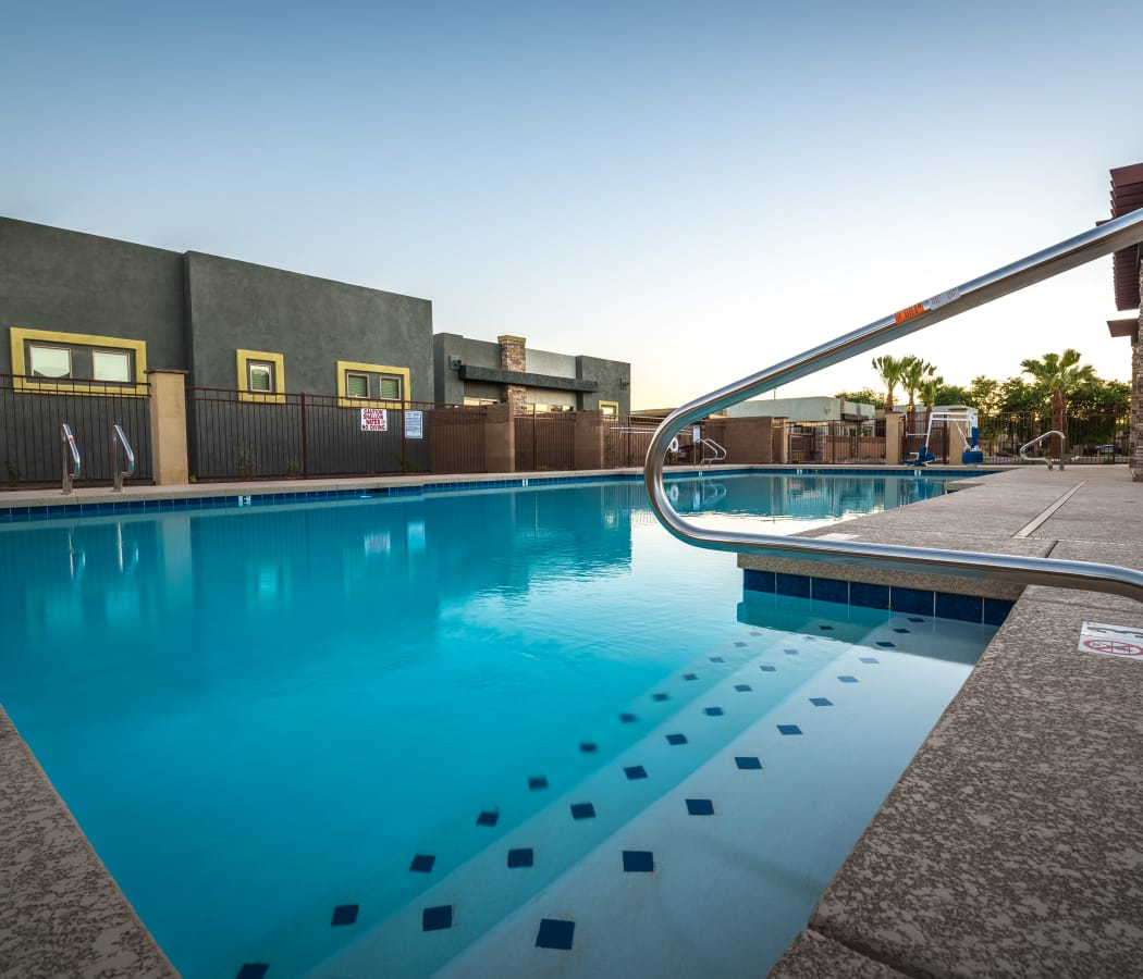 Shimmering swimming pool at Avilla Grace apartments in Chandler, Arizona