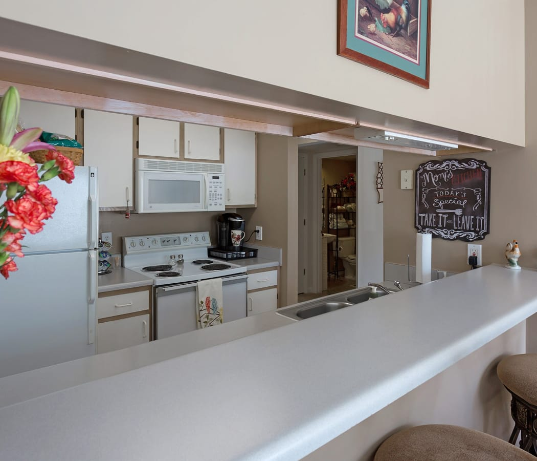 Crescent Oaks offers a beautiful kitchen with breakfast bar in Graham, North Carolina