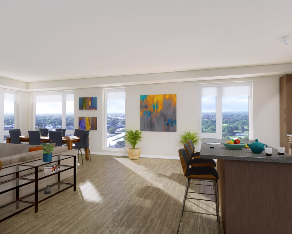Model living room and kitchen at The Maven on Broadway in Rochester, Minnesota