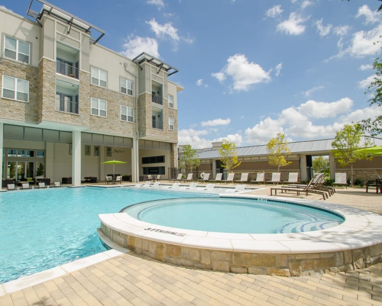 Beautiful swimming pool area at GreenVue Apartments