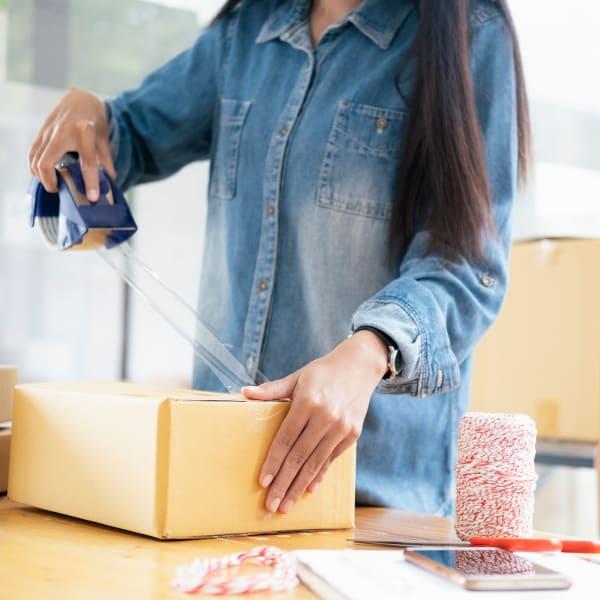 A woman packing a box at Hayward Self Storage in Hayward, California