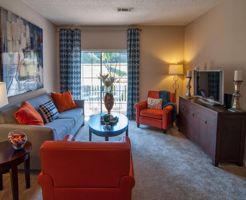 Comfortably decorated living area in a model home at Amber Chase Apartment Homes in McDonough, Georgia