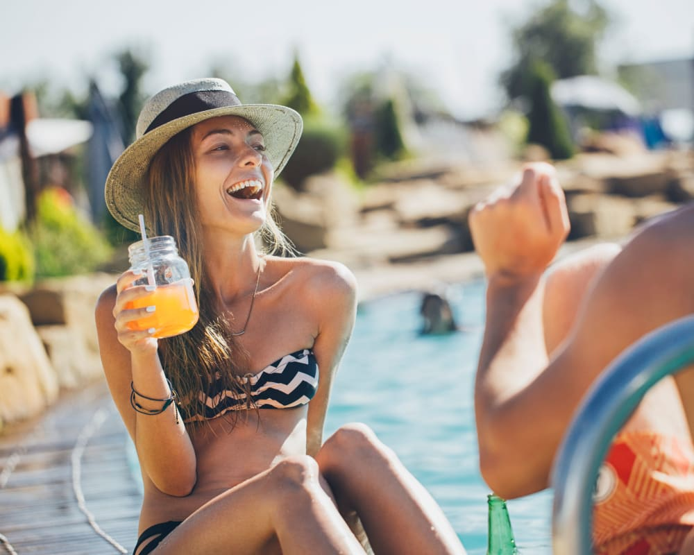Residents enjoying a beverage by the pool together on another sunny day at Sofi Westview in San Diego, California