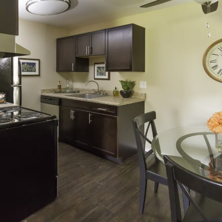 Dining area and kitchen at Callaway Apartments in Taylorsville