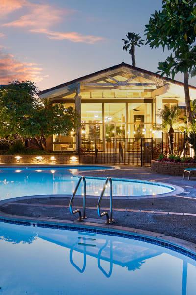 Resort-style swimming pool at Mediterranean Village Apartments in Costa Mesa, California