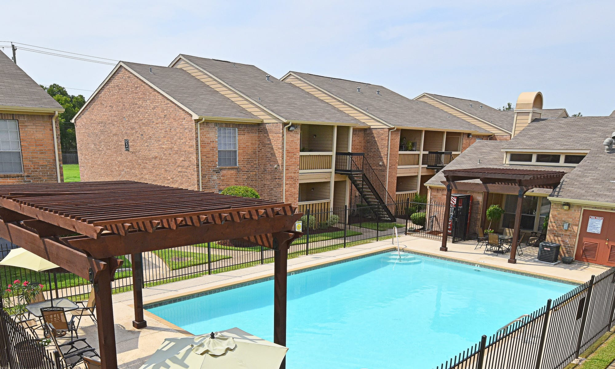 Swimming pool at Brookmore Hollow Apartments in Rosenberg, TX