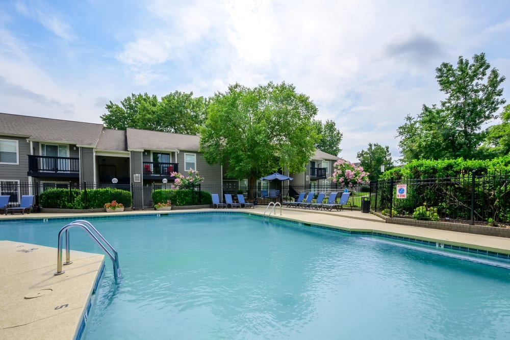 Large swimming pool surrounded by mature trees at The Hamilton in Hendersonville, Tennessee
