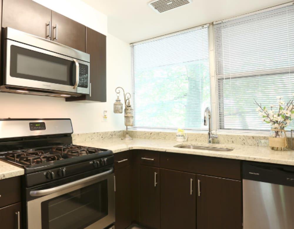 Kitchen with stainless steel appliances at Cherokee Apartments in Philadelphia, Pennsylvania