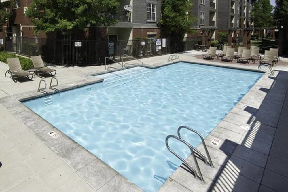 Exterior Pool At Irving Schoolhouse Apartments
