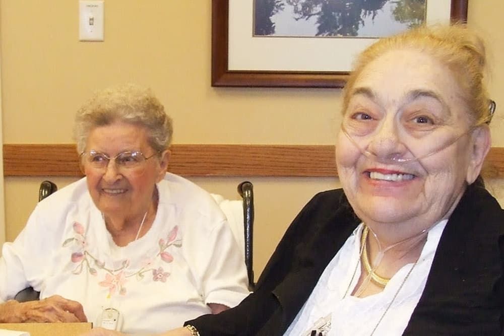 two residents smiling