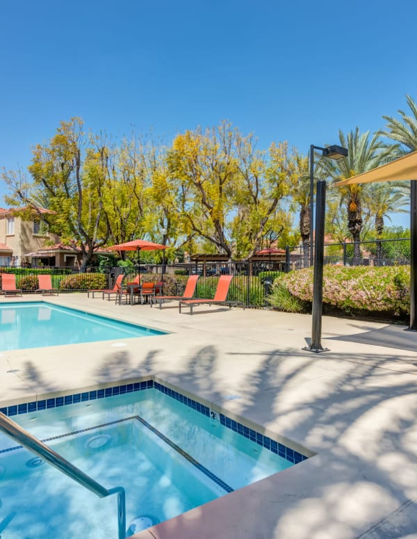 Hot Tub, pool, sun shade, and lounge area at Tuscany Village Apartments in Ontario