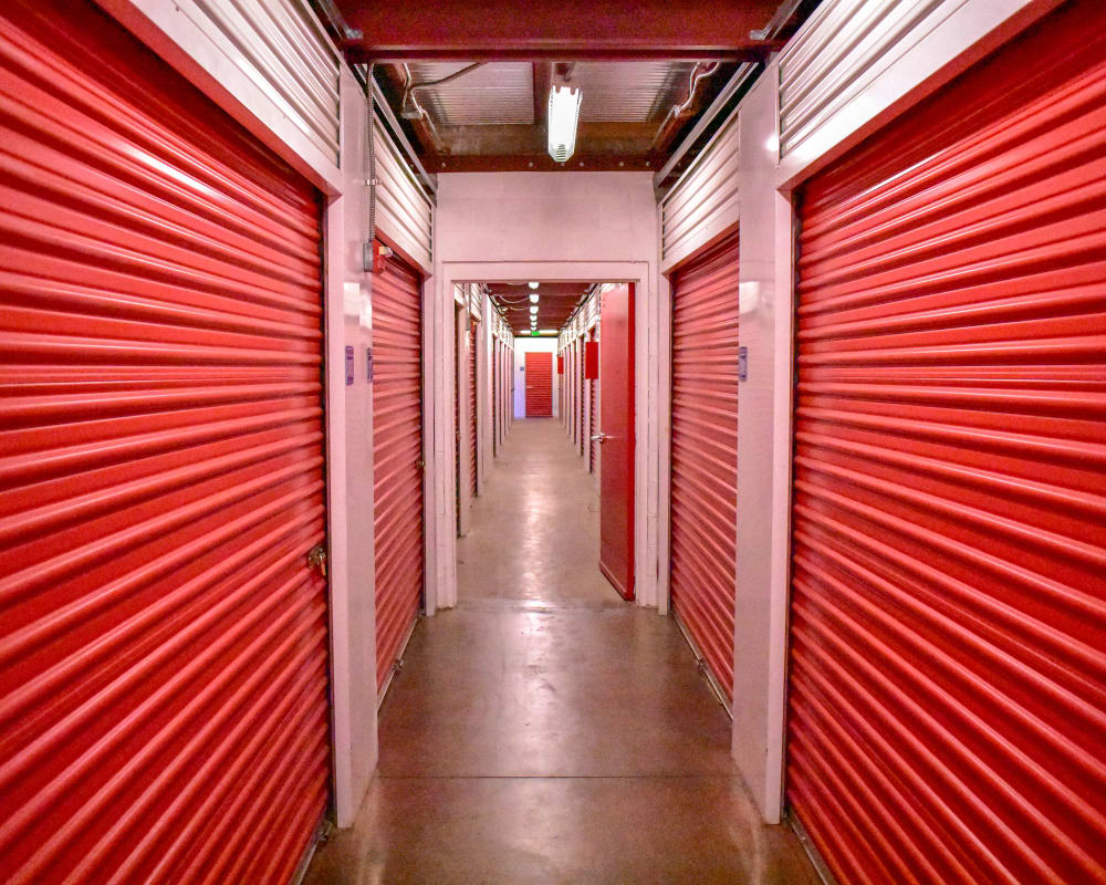 Red doors on interior climate-controlled storage units at STOR-N-LOCK Self Storage in Aurora, Colorado