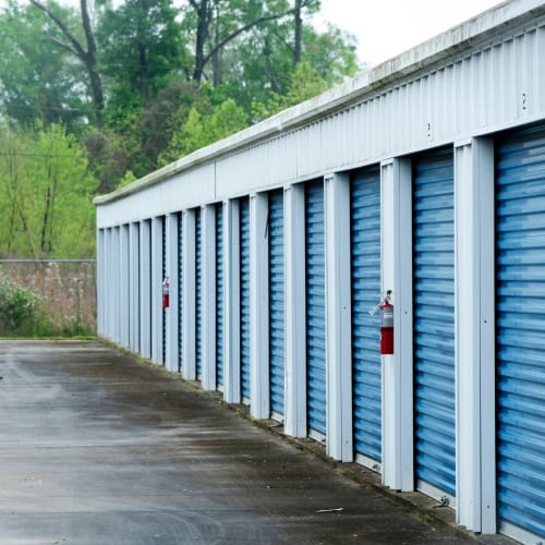Row of storage units with blue doors at Red Dot Storage in Baker, Louisiana