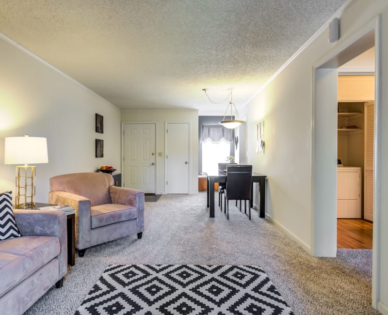 Spacious floor plans with carpeting at Coach House Apartments in Kansas City, Missouri