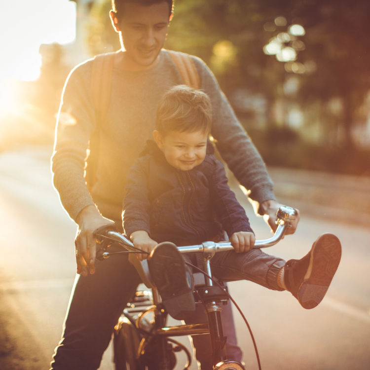 Resident riding his bike with his son near The District in Charlotte, North Carolina