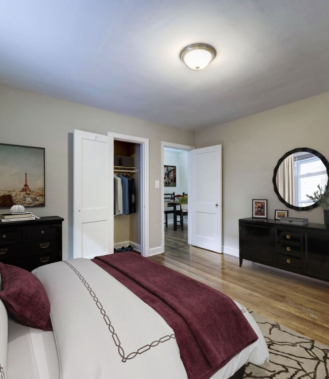 Modern bedroom with closet in a model home at Avondale Apartments in Bethesda, Maryland