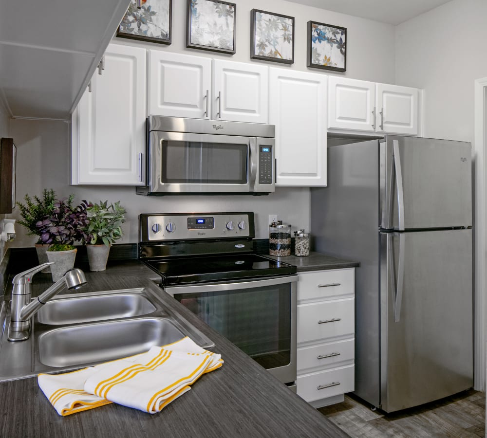 Kitchen with stainless-steel appliances at Cortland Village Apartment Homes in Hillsboro, Oregon