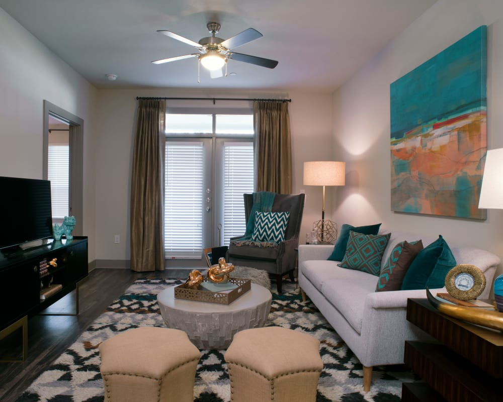 Living room with large windows at Savannah Oaks in San Antonio, Texas
