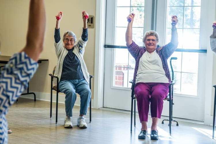 Residents enjoy some chair exercises at Harmony at West Ashley in Charleston, South Carolina