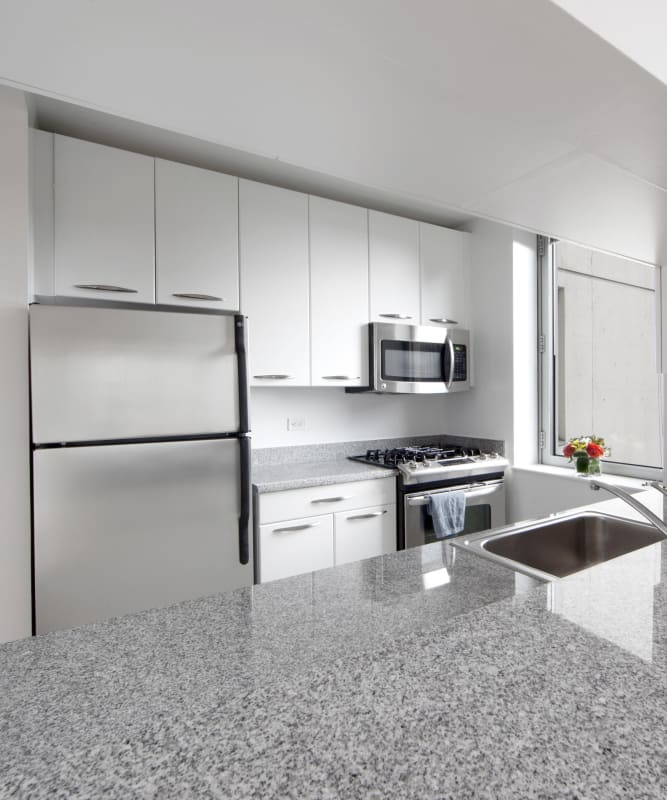 A kitchen with granite counter tops at The Metropolis in New York, New York
