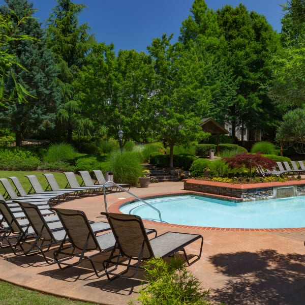 Chaise lounge chairs around the pool at The Vinings at Newnan Lakes in Newnan, Georgia
