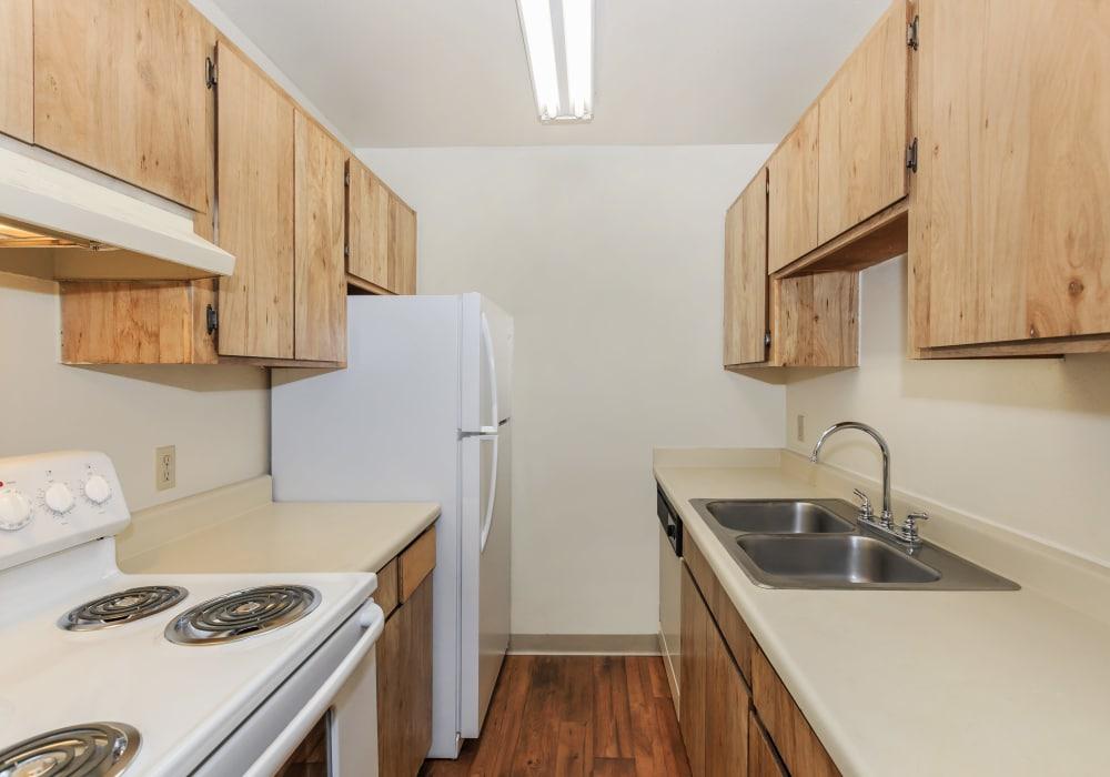 Kitchen with white appliances at Verde Apartments in Tucson, Arizona