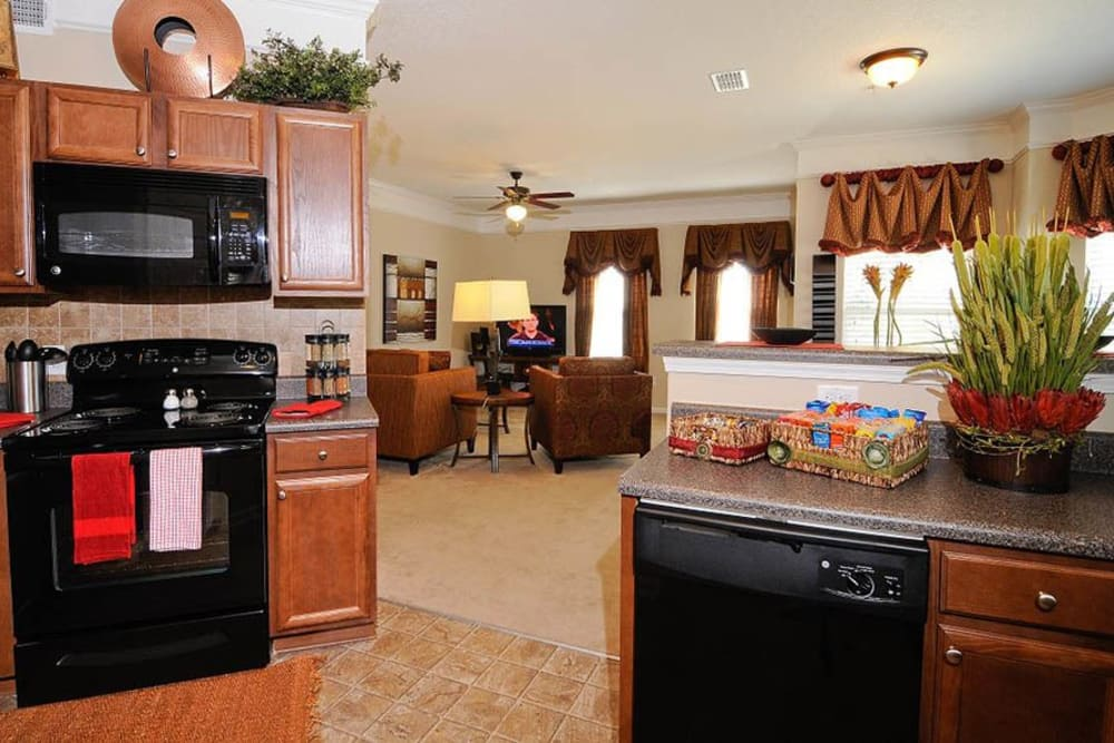 Living room and kitchen at apartments in Cordova