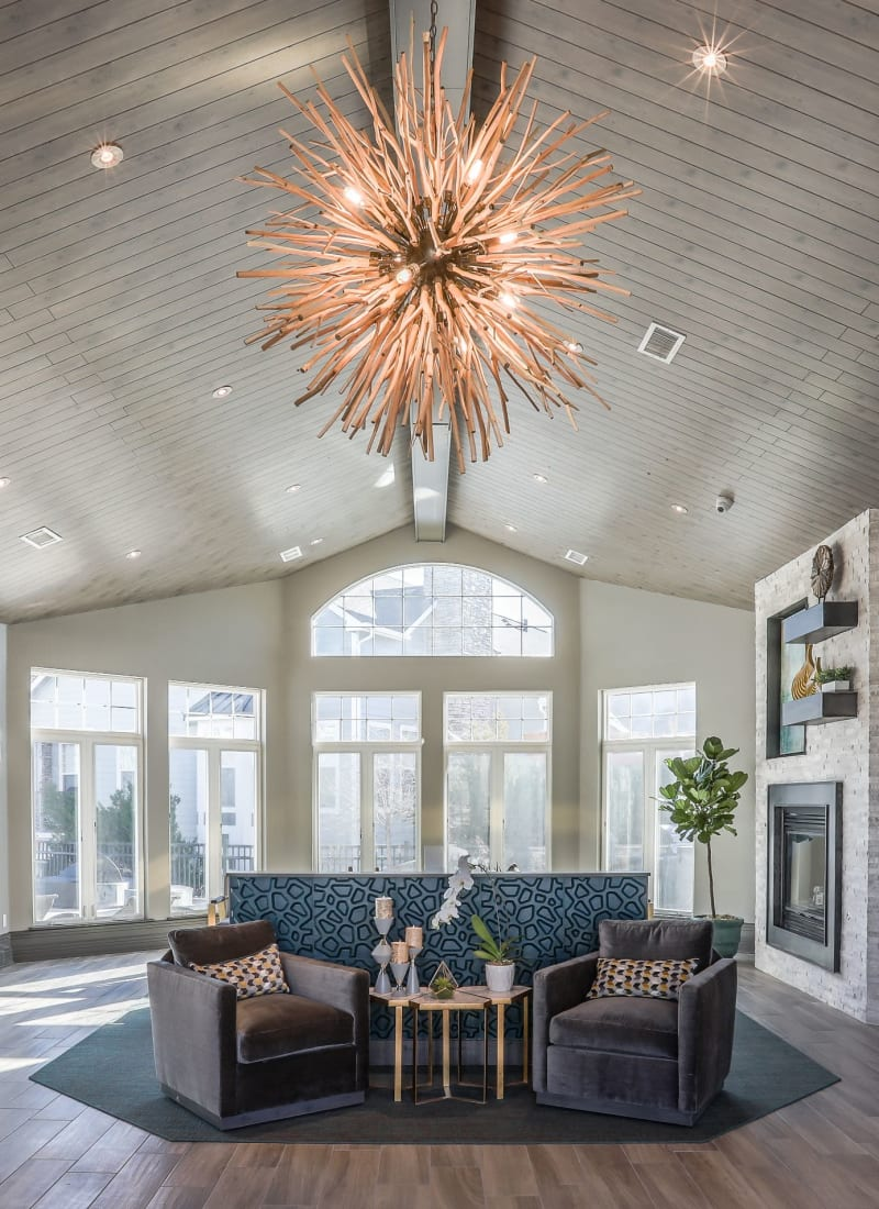 Lobby entrance with sitting area and large windows at Marquis Castle Pines in Castle Pines, Colorado
