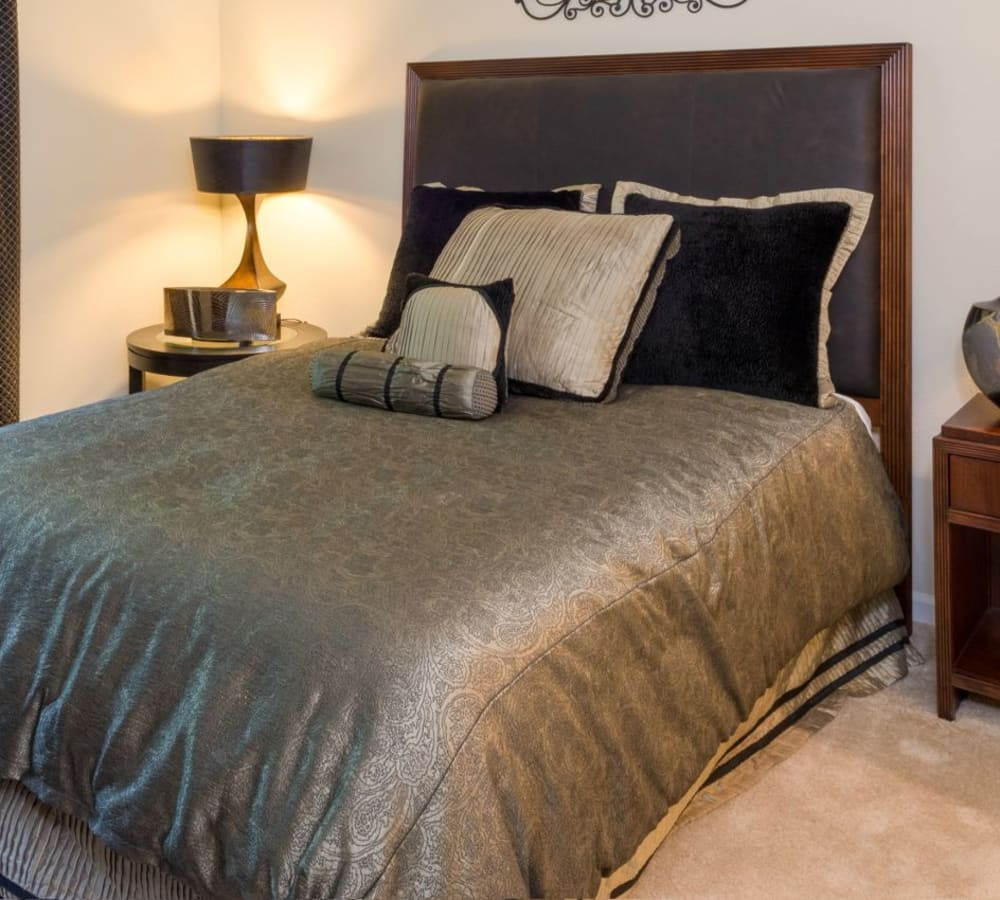 Large bedroom with plush carpeting at The Artisan Apartment Homes in Sacramento, California