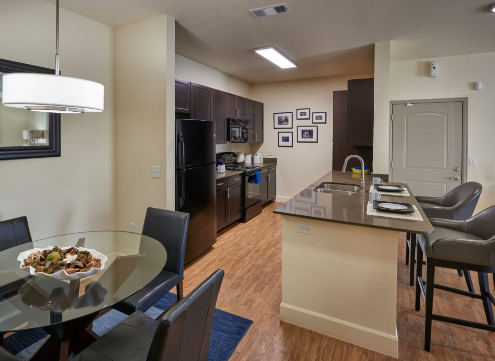 A kitchen and dining room at M2 Apartments in Denver, Colorado