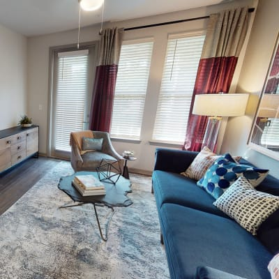 Bright furnished living room at Integra 289 Exchange in DeBary, Florida