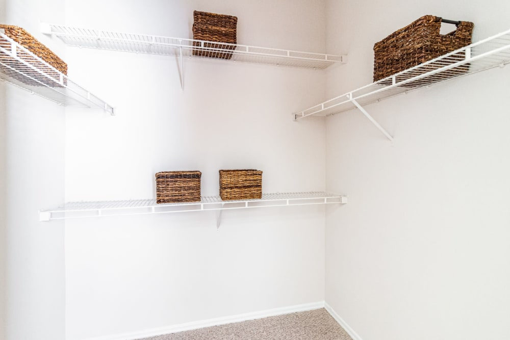 Walk in closet with built in organizer shelves at Marquis of Carmel Valley in Charlotte, North Carolina