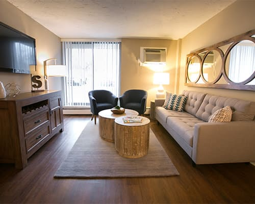 Living room with patio access at Solon Club Apartments in Oakwood Village, Ohio