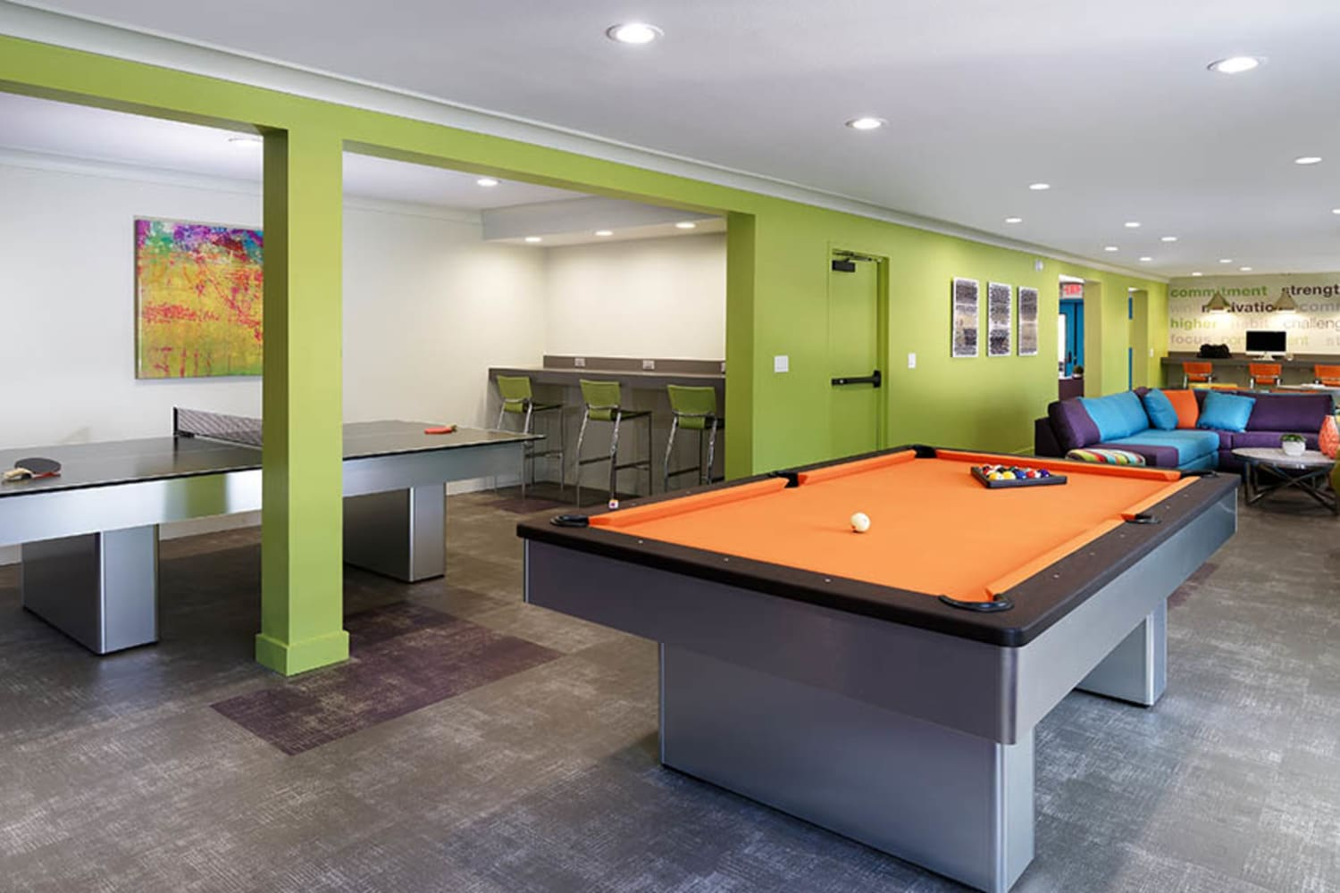 UCA Apartment Homes in Fullerton, California, offer a clubhouse with a pool table